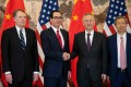 China's Vice-Premier Liu He shakes hands with US Treasury Secretary Steven Mnuchin as People's Bank of China Governor Yi Gang and US Trade Representative Robert Lighthizer pose in Beijing on March 29, as the two countries' top negotiators began a fresh round of trade talks. Photo: AFP