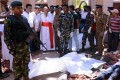 Colombo's Archbishop Malcolm Ranjith looks at the explosion site inside a church in Negombo, Sri Lanka. Photo: Reuters