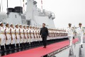 Chinese President Xi Jinping inspects the honour guards of the Chinese People's Liberation Army Navy before boarding the destroyer Xining in Qingdao, Shandong province, on Tuesday. Photo: Xinhua