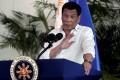Philippines President Rodrigo Duterte speaks after his arrival at Davao international airport in September. Photo: Reuters