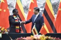 Zimbabwean President Emmerson Mnangagwa shakes hands with Chinese President Xi Jinping in Beijing in April 2018. China surpassed the US as the top trading partner of Africa in 2009. Photo: EPA-EFE