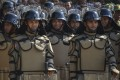 Indonesian Public Order Agency officers don riot gear for a security roll-call in Banda Aceh on April 11. Photo: AFP
