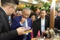 Prime Minister Mahathir Mohamad and his wife (R) at the Malaysian Durian Festival in Beijing. Photo: PLS Plantations Berhad