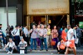 Chinese tourists waiting in front of Galeries Lafayette department store. Photo: Alamy