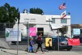 Pedestrians walk past the Michael Jackson Auditorium at Gardner Street Elementary school in Hollywood. Photo: AFP