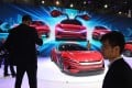 Visitors to the Shanghai Auto Show photograph the BYD E-SEED GT electric concept caron April 17, 2019. Photo: AFP