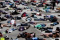 """Extinction Rebellion climate change activists lie on the floor to symbolise a """"mass die"""" at the Gendarmenmarkt square in Berlin on April 27. Photo: AFP"""