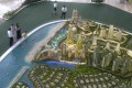 Visitors viewing the scale model of Country Garden Holdings' Forest City project on the Malaysian side of the Straits of Johor near Singapore on April 19, 2016. Photo: Agence France-Presse