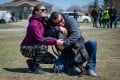 Anne-Marie St-Louis and Robert Tourangeau embrace their dog Harley after he was rescued in the Sainte-Marthe-sur-le-Lac, Quebec on Monday. Photo: AFP