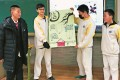 Trey Crawford (second left) displays a school project with other pupils at the high school affiliated to the University of Science Technology Beijing, China. Photo: Handout