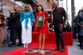 Singleton with Mary J Blige and actress Taraji P Henson, who had just received a star on Hollywood's Walk of Fame in January 2019. Photo: Reuters
