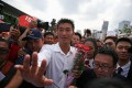 Thanathorn Juangroongruangkit, leader of the Future Forward Party, surrounded by supporters. Photo: Reuters