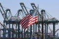 A US flag flying at the Port of Long Beach, in Los Angeles county. In the first three months of the year, the US economy expanded at a better-than-expected 3.2 per cent on an annualised basis. Photo: AFP