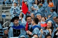 Graduates wave China flags during the commencement ceremony of the 264th Academic Year of Columbia University in New York. Photo: Xinhua