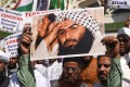 Indian Muslims with photo of Jaish-e-Mohammad chief, Masood Azhar, at an anti-Pakistan protest in Mumbai. Photo: AFP