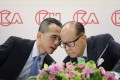 Hong Kong tycoon Li Ka-shing (right) confers with his son Victor Li at CK Hutchison Holdings' results announcement on March 16, 2018. Since Li Ka-shing's retirement, Victor Li has taken up his father's mantle. Photo: AP