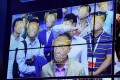 Visitors experience facial recognition technology at the Megvii booth during the China Public Security Expo in Shenzhen in 2017. Photo: Reuters