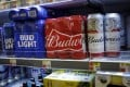 Anheuser-Busch InBev, the brewer behind Budweiser and Bud Light, is planning an IPO of its Asia-Pacific operations in Hong Kong. Photo: Getty Images/AFP