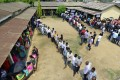 Voters queue at a polling station in Guwahati, Assam, on April 23. Photo: EPA