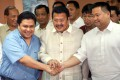 Jinggoy Estrada (in blue), pictured with his dad Joseph Estrada, and half-brother JV Ejercito in 2004. Photo: AFP