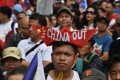 Anti-China protesters chant slogans in front of the Chinese embassy in the financial district of Manila on April 9. Photo: AFP