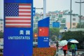 Signs with the US flag and Chinese flag are seen outside a store selling foreign goods in Qingdao in China's eastern Shandong province on September 19, 2018. – China on September 18 announced tariffs on US goods worth $60 billion in retaliation for President Donald Trump's decision to slap duties on $200 billion in Chinese products next week. Photo: Agence France-Presse