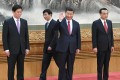Chinese President Xi Jinping waves to reporters from the podium with members of his leadership team including Premier Li Keqiang, Li Zhanshu, and Wang Huning at the Great Hall of the People in Beijing. Photo: Kyodo