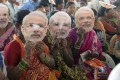 Women supporting the Bharatiya Janata Party wear masks of Prime Minister Narendra Modi at a rally in Hyderabad last month. Photo: AFP