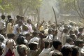 A Hindu mob faces off with a Muslim mob during during Gujarat's 2002 riots. Photo: AFP