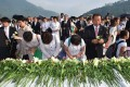 Followers of the Unification Church lay flowers in tribute to Reverend Sun Myung Moon. Photo: AFP