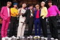 BTS wear Juun.J sneakers on Saturday Night Live. The K-pop stars have retailers lining up to sponsor them in the hope of their success rubbing off.
