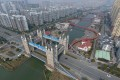 A bridge modelled on London's Tower Bridge in Suzhou, in China's eastern Jiangsu province. New home prices rose in 67 out of the 70 cities monitored by China's National Bureau of Statistics in April. This prompted the housing ministry to warn four cities, including Suzhou, that they were showing signs of overheating. Photo: AFP