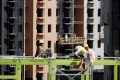Workers are seen at a construction site of residential buildings in Zhengzhou, Henan province, China on September 3, 2018. Photo: Reuters