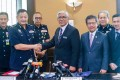 Malaysian anti-corruption adviser Abu Kassim Mohamed with the newly minted police chief Abdul Hamid Bador. Photo: Malaysian Home Ministry