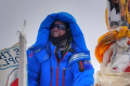 Adrian Ballinger sits atop Everest, becoming one of about 200 climbers to reach the peak without supplementary oxygen. Photo: Handout