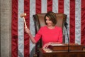 Speaker of the House Nancy Pelosi holds up the gavel as the 116th Congress convenes. Photo: The Washington Post