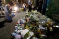 A local resident prays to mourn victims of Tuesday's mass stabbing in Kawasaki, Japan. Photo: Reuters