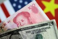 US Dollar and China Yuan notes are seen in this picture illustration on June 2, 2017. Photo: Reuters