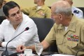 Honduran President Juan Orlando Hernandez listens to then US Marine General John Kelly in 2014 as the US DEA was investigating the leader for 'drug trafficking'. Photo: AP