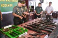 Military officials inspect weapons confiscated from ex-Aceh rebels in Banda Aceh. Photo: AFP