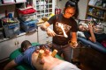 Toto Cheng, a practitioner of traditional Chinese medicine, performs cupping therapy on a client in her clinic in North Point, Hong Kong. A sportswoman herself, her clients are involved in various sports. Photo: Laurel Chor