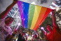 LGBT supporters in Hong Kong celebrate Taiwan's vote to legalise same-sex marriage. Photo: Dickson Lee
