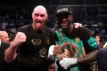 Tyson Fury and Deontay Wilder pose after their December 2018 fight. Photo: Reuters
