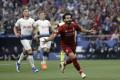 Liverpool's Mohamed Salah celebrates after scoring. Photo: AP