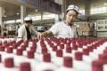 Employees arrange bottles of Moutai baijiu at the Kweichow Moutai factory in the town of Maotai in Renhuai, Guizhou province, China, on December 14, 2017.