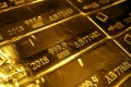 A mark of 999.9 fine sits on hallmarked 12.5 kilogram gold bullion bars stacked at the Valcambi SA precious metal refinery in Lugano, Switzerland, on April 24, 2018. Photo: Bloomberg