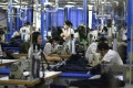 Caixin/Markit Manufacturing Purchasing Managers' Index (PMI) data showed a different trend from the official government PMI data, which fell more than expected to 49.4, indicating a contraction in the Chinese manufacturing sector activity in May. Photo: AFP