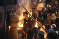 Supporters of defeated presidential candidate Prabowo Subianto stand near a fire during clashes with police in Jakarta on May 22. Photo: AP