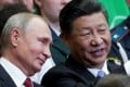 Vladimir Putin and Xi Jinping pictured in Vladivostok last year. Photo: Reuters