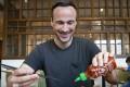 SCMP reporter Patrick Blennerhassett puts some Sriracha hot sauce on his chicken wings at Nha Trang restaurant, Times Square, Hong Kong. Photo: Antony Dickson